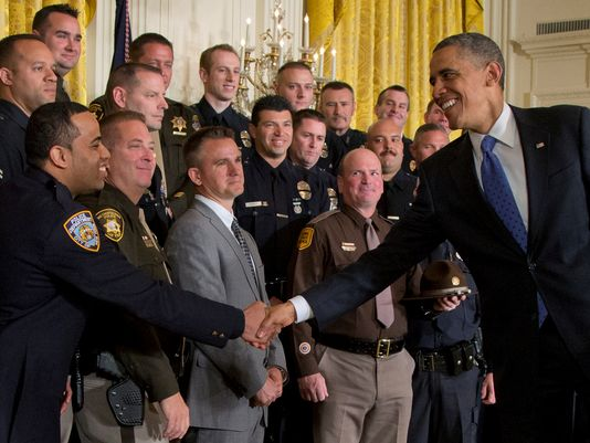Obama praises courage of police